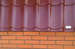 Металлочерепица Diament на заборе